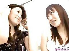 2 Asian Girls Rubbing Tits While Standing In The Room